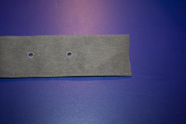 a gray green belts is cut near the belt holes.