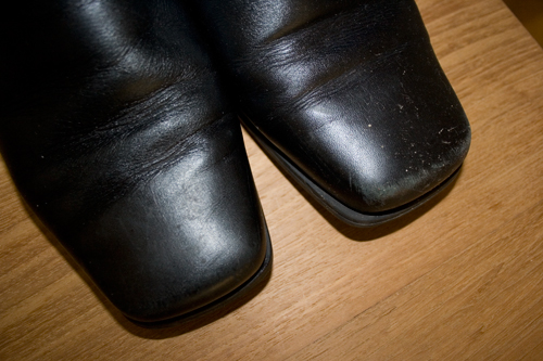 close up of the tops of black leather boots