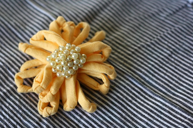 yellow flower broick made with a yellow shirt material and small pearls