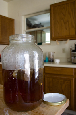 a glass jar is filled half way with iced tea