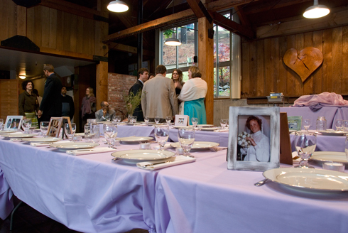 photo sit on top of a lavendar table cloth as a centerpiece