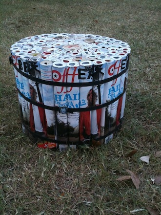 a stool made from magazines