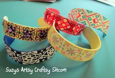 stack of bracelets made from popsicle sticks
