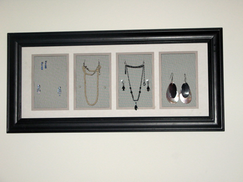 a close up of a black photo frame that has been turned into a jewelry holder