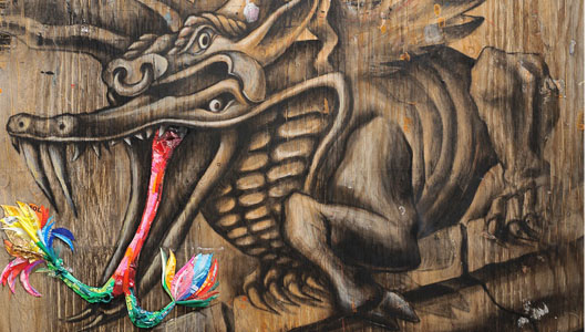 gargoyle drawn on reclaimed wood with accents of color made from trash