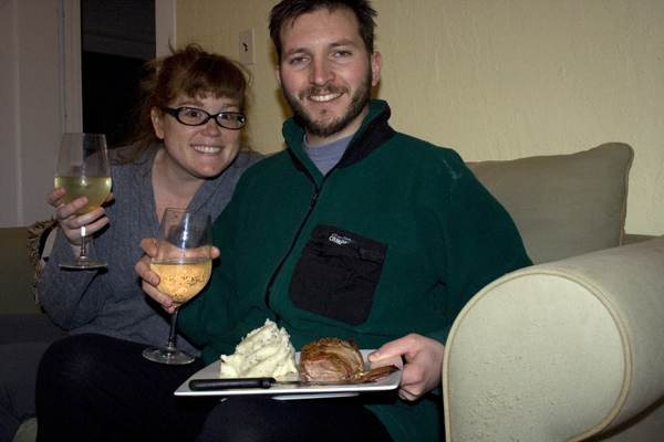 photograph of a husband and wife with wine and dinner