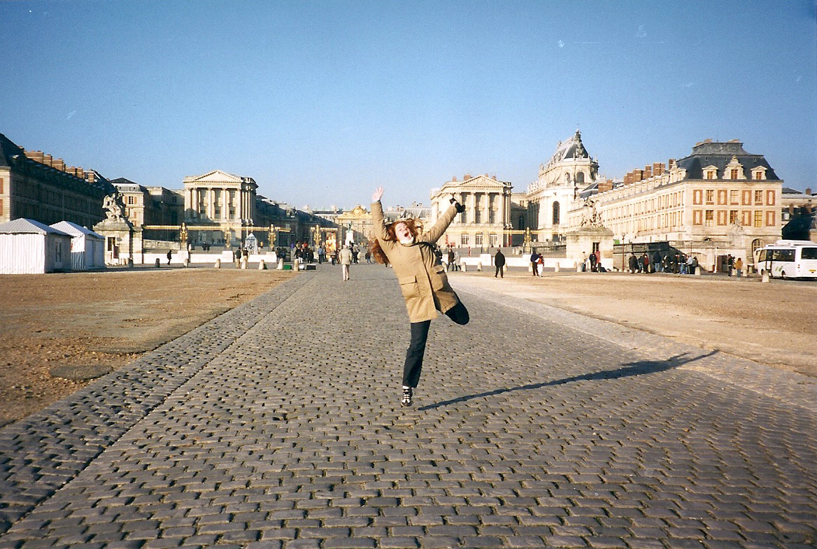 a young woman jumping for joy in France