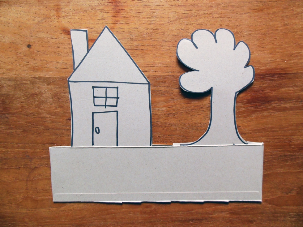 cut out of a simple drawing of a house and tree